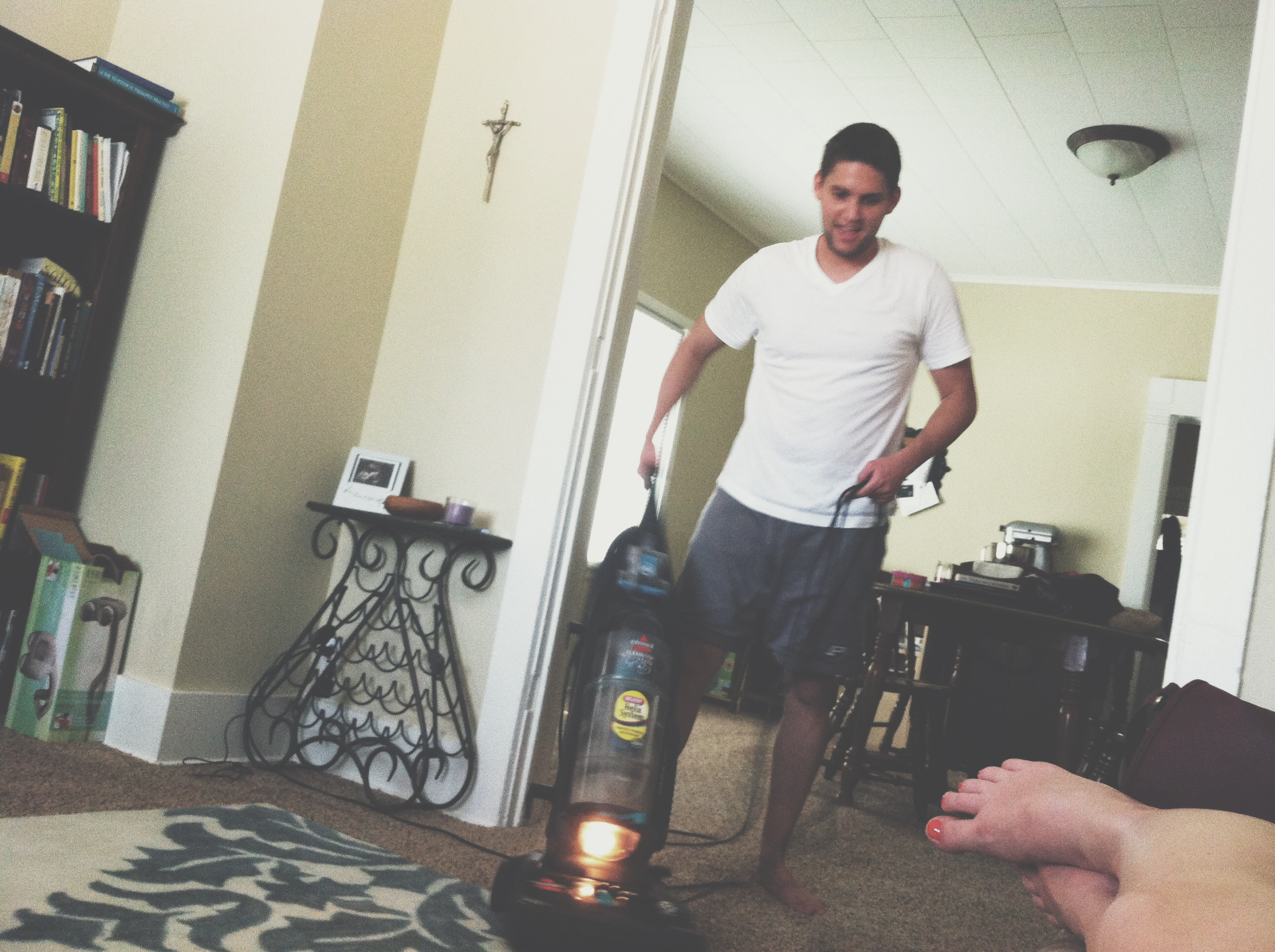 husband vacuuming