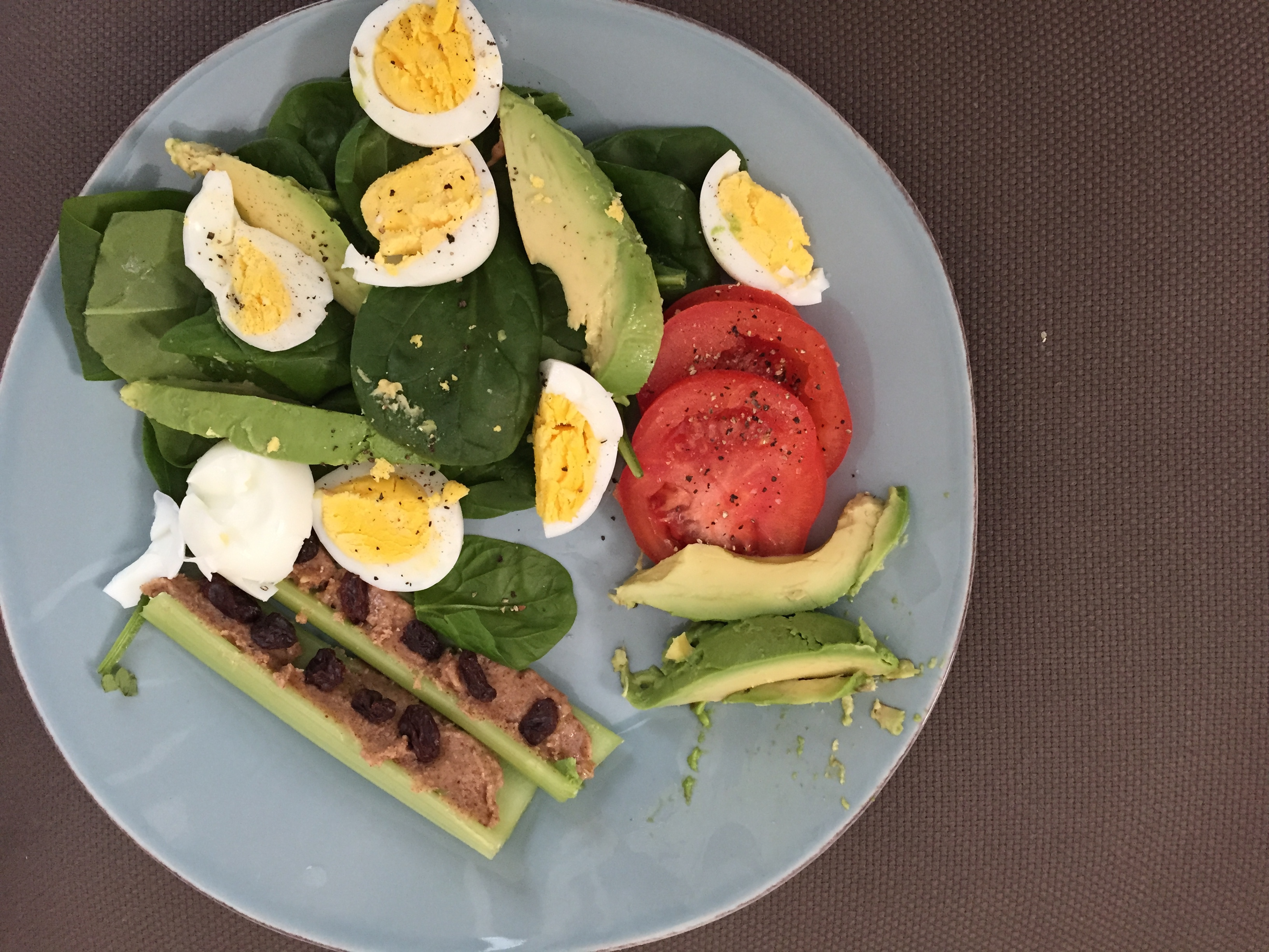 spinach, egg, tomato, avocado, celery with homemade almond butter and unsweetened raisons
